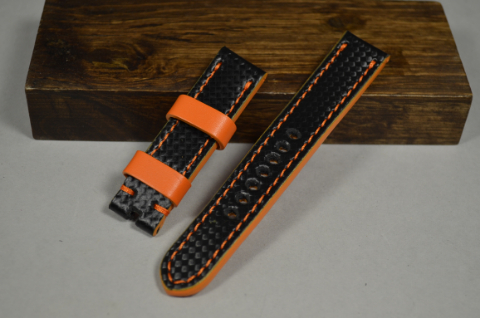 127 CARBON ORANGE 20-20 130-80 MM is one of our hand crafted watch straps. Available in orange color, 4 - 4.5 mm thick.