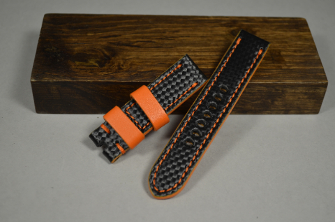 128 CARBON ORANGE 20-20 130-80 MM is one of our hand crafted watch straps. Available in orange color, 4 - 4.5 mm thick.