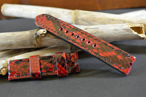 RED II 20-20 115-75 MM A is one of our hand crafted watch straps. Available in red color, 4 - 4.5 mm thick.