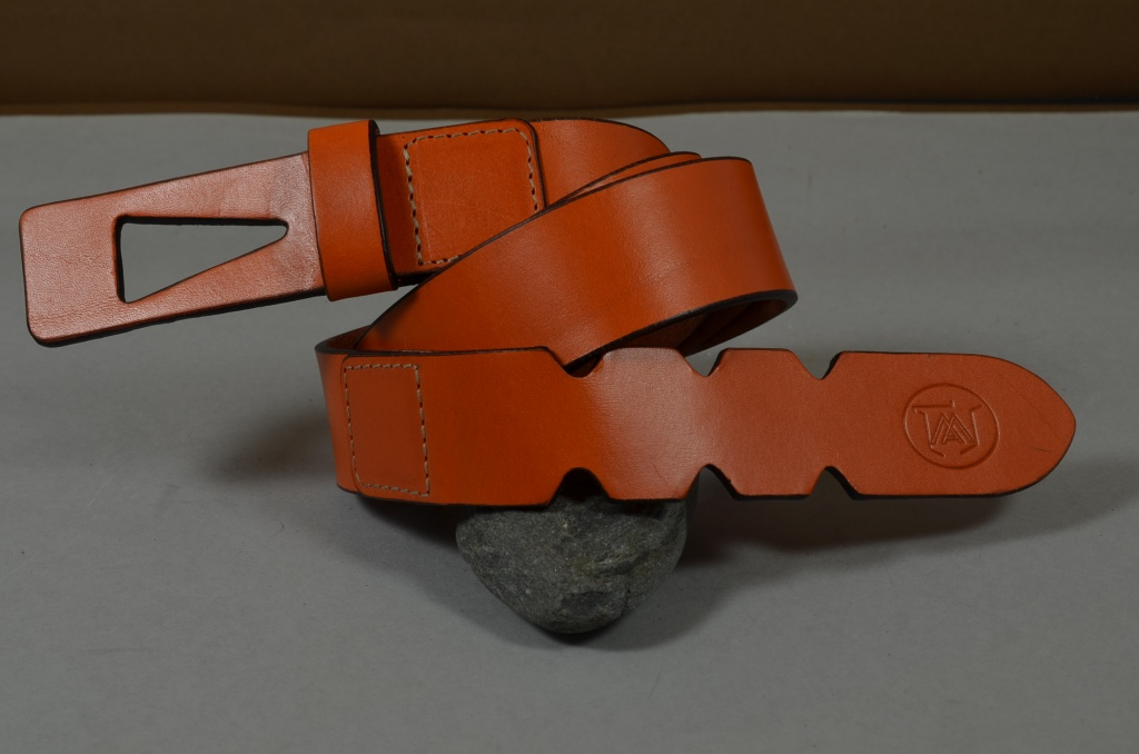 35MM CALF DESIGN ARROW ORANGE is one of our hand crafted belts, made with exceptional quality calf saddle leather. Available in orange color, 35 mm wide & 3.5 - 4 mm thick.