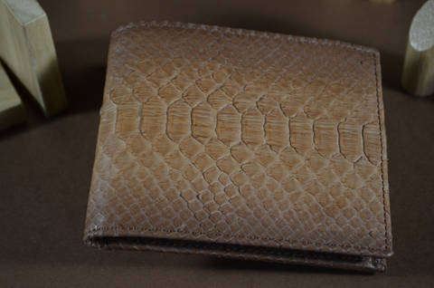 ROMA - PYTHON 9 TABAC is one of our hand crafted wallets, made using python belly matte & calfskin / textil in the interior. Available in tabac mat color.