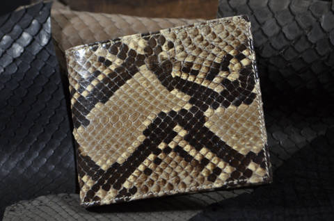 FIRENZE - PYTHON 47 BEIGE is one of our hand crafted wallets, made using undefined & undefined in the interior. Available in undefined color.