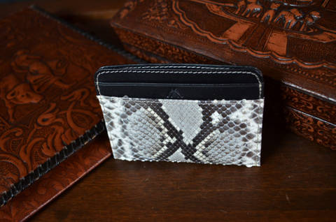 AMALFI - PYTHON 17 WHITE is one of our hand crafted wallets, made using python back shiny & calfskin / textil in the interior. Available in white color.