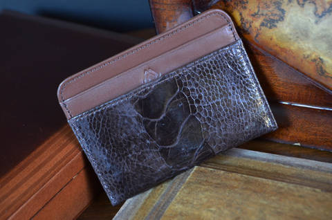 AMALFI - OSTRICH LEG 28 BROWN is one of our hand crafted wallets, made using ostrich leg shiny & calfskin / textil in the interior. Available in brown color.