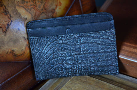 AMALFI - OSTRICH LEG 33 BLACK FANTASY is one of our hand crafted wallets, made using ostrich leg matte & calfskin / textil in the interior. Available in black fantasy color.