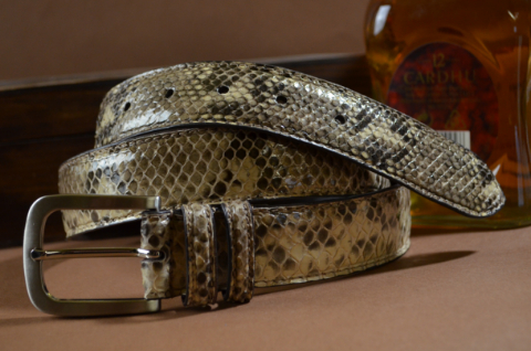 35MM EXOTIC PYTHON BEIGE SHINY is one of our hand crafted belts, made with exceptional quality python back shiny. Available in beige color, 35 mm wide & 3.5 - 4 mm thick.