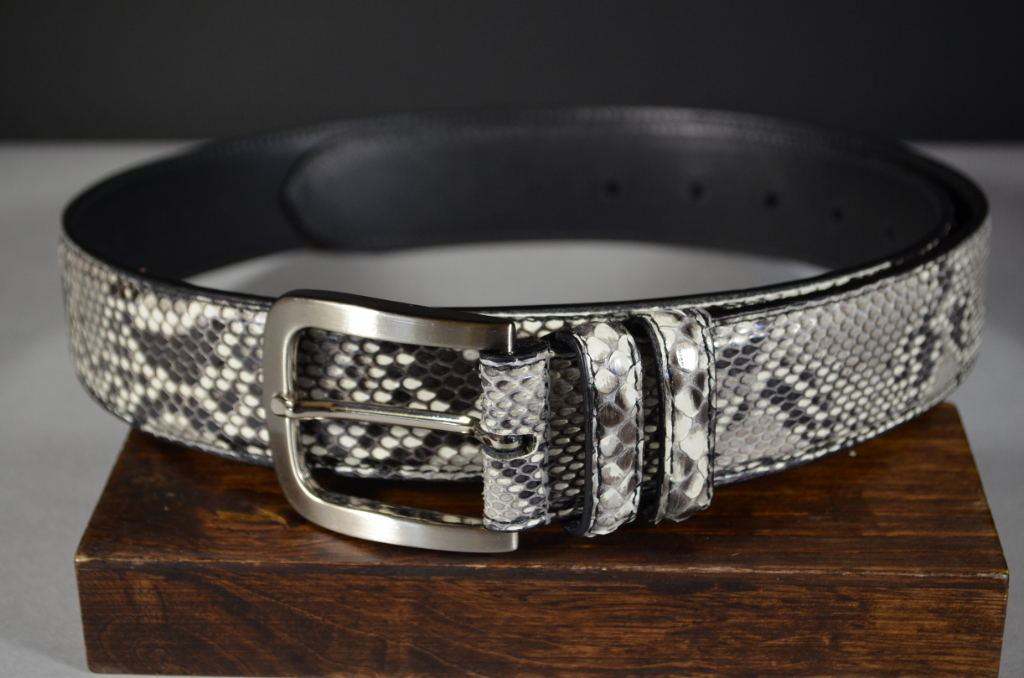35MM EXOTIC PYTHON WHITE SHINY is one of our hand crafted belts, made with exceptional quality python back shiny. Available in white color, 35 mm wide & 3.5 - 4 mm thick.