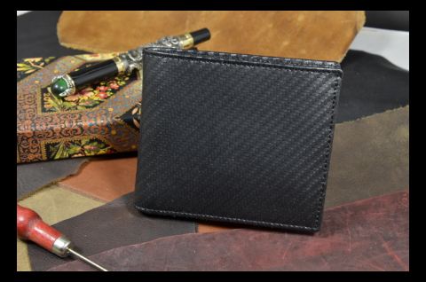 ROMA - CALF 28 CARBON BLACK is one of our hand crafted wallets, made using calf leather & calfskin / textil in the interior. Available in black color.