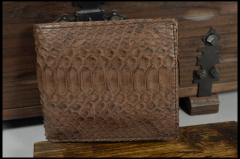 ROMA - PYTHON 15 BROWN MATTE is one of our hand crafted wallets, made using python belly matte & calfskin / textil in the interior. Available in brown color.