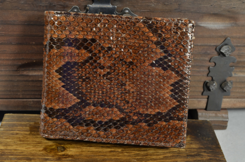 ROMA - PYTHON 28 BROWN SHINY is one of our hand crafted wallets, made using python back shiny & calfskin / textil in the interior. Available in brown color.