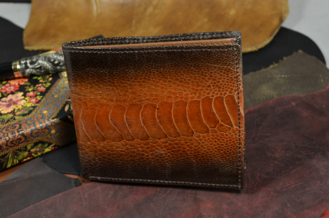 FIRENZE - OSTRICH LEG 69 HONEY is one of our hand crafted wallets, made using ostrich leg shiny & calfskin / textil in the interior. Available in honey color.